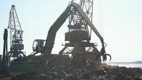 Ship loader scrap in harbor,Freight train, ship and scrap metal in port stock video