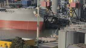 Ship for loading cargo in seaport. The ship is moored to the pier. commercial port with big boat. shipping stock video