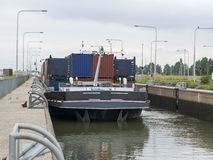 Ship in lock in netherlands. Cargo ship in the maas river lock in holland royalty free stock photography