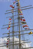 Ship Mast. With flags against blue sky Royalty Free Stock Photography