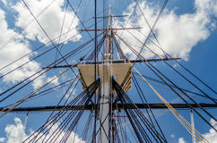 Ship Mast against a blue sky. Ship Mast of the USS Constitution Warship, against a blue sky stock image