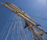 Ship mast on blue sky. Ship mast with housed sails on the blue sky Royalty Free Stock Photography