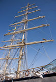 Ship mast on blue sky. Ship mast with housed sails on the blue sky Royalty Free Stock Images
