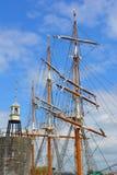 Ship mast and lighthouse Royalty Free Stock Photos
