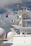 Ship Mast. This is a mast of one of the many cruise ship in the Royal Caribbean lines,  flying their colors Royalty Free Stock Photo
