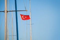 Ship mast with the Turkish flag over blue sky Royalty Free Stock Photography