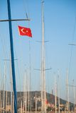 Ship mast with the Turkish flag over blue sky Stock Photo