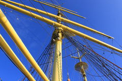 Ship mast. Yellow mast of ship on blue sky background Royalty Free Stock Image