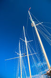 Ship masts. Against the blue sky Stock Image
