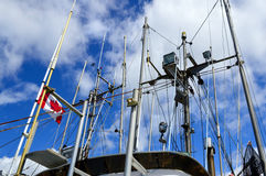 Ship masts and Canadian flag Stock Photos