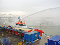 Ship melts the ice by steam gun in the harbor Royalty Free Stock Photo