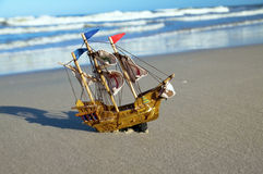 Ship model on summer sunny beach Stock Photography