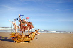 Ship model on summer sunny beach Royalty Free Stock Image