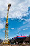 Ship and monumental crane in the shipyard Stock Images