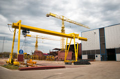 Ship and monumental crane in the shipyard Royalty Free Stock Images