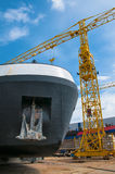 Ship and monumental crane in the shipyard Stock Photo