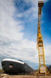 Ship and monumental crane in the shipyard Royalty Free Stock Photo