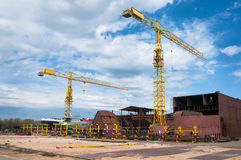 Ship and monumental crane in the shipyard Royalty Free Stock Photography