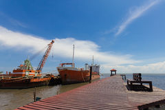 Ship and monumental crane in the shipyard. Royalty Free Stock Image