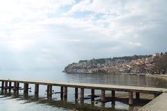 Ship moored near the pier of Ohrid lake. OHRID, MACEDONIA - MARCH 12, 2017: Ship moored near the pier of Ohrid lake Royalty Free Stock Images