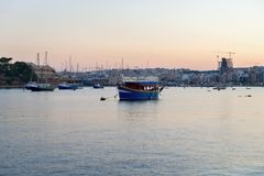 Ship moored in St. Elmo bay, Valetta, Malta. Royalty Free Stock Photo
