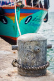 The ship is at mooring cleat in the harbor Royalty Free Stock Photography