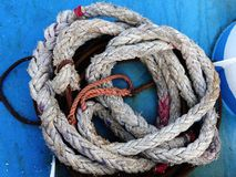 Ship Mooring Rope. A coil of heavy ship mooring rope on blue deck Stock Images