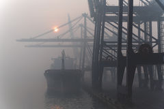 Ship in the morning mist. Ship at the pier in the morning mist during loading Stock Images