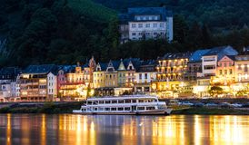 Ship on Moselle River at night in Cochem Germany stock photos