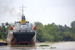 Ship in muddy river Royalty Free Stock Photo