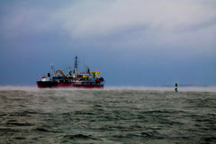 A ship and a navigational buoy stock photography