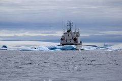 Ship near coast among the ice floe stock image