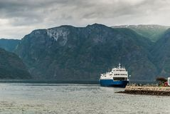 Ship near the pier in the Aurlandsfjord fjord Royalty Free Stock Photos