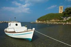 Ship near the tower. Nea Fokea, Greece Royalty Free Stock Photos