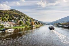 Ship on Neckar river, city background. Ship on Neckar river on city background Royalty Free Stock Photo