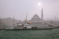 Ship and New Mosque at Istanbul,Snowy Day Stock Photos