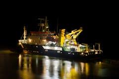 Ship at night. Colorfully illuminated coast guard ship in open water at night Royalty Free Stock Photo