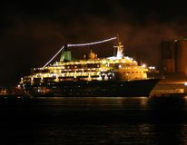 Ship at night. A night shot of a ship in a small port, yellow tone royalty free stock photography