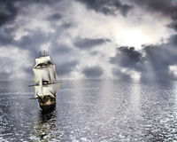 Ship on the ocean. A lone ship on the ocean at sunset Stock Image