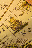 Ship and old map. Map is a drawing or plan of the surface of the earth that shows countries, mountains, roads, etc Stock Photo