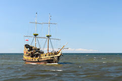 Ship on open seas. Ship sailing open seas on sunny day Stock Image
