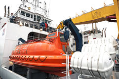 ship with orange lifeboat Stock Photo
