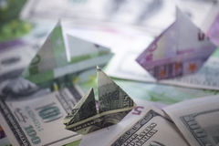 Ship origami banknotes Stock Images