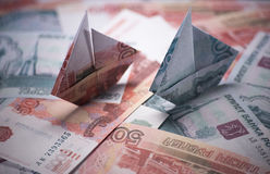 Ship origami banknotes Royalty Free Stock Images
