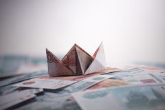 Ship origami banknotes Stock Photography