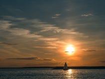 Ship out at sea at sunset. Royalty Free Stock Image