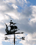 Ship Outline Weather Vane. Ship Outline Antique Weather Vane against an Overcast Sky Royalty Free Stock Photo
