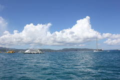 Ship over the blue blue. Cottony clouds over the blue sea with ships in Boracay, Philippines royalty free stock images
