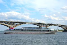 A ship passes under the bridge. Through the Volga River in Saratov Royalty Free Stock Images