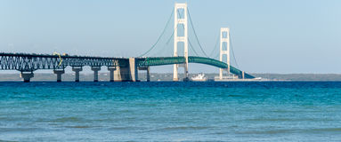 Ship passes under the Mackinac Bridge in Michigan Stock Images